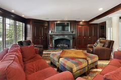 Family room with cherry wood cabinetry Royalty Free Stock Photo