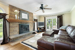 Family room with fireplace Stock Photography