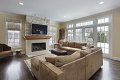 Family room with fireplace Stock Images