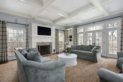 Family room with fireplace Stock Photos