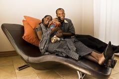 Family Room Fun - Family Cuddles Stock Photos