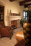 Family room home fireplace. A large fireplace warms this beautifully furnished family room Stock Image