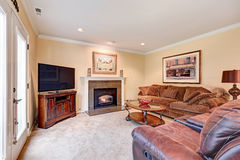 Family room interior in brown and beige tones Royalty Free Stock Images