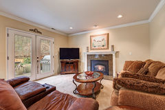 Family room interior in brown and beige tones Royalty Free Stock Image