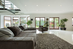 Family room. Luxury big family room with view overlooking the garden royalty free stock image