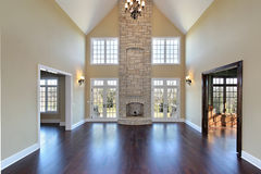 Family room in new construction home. With two story stone fireplace Royalty Free Stock Images
