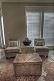 Family Room Sitting Area. With Chairs and Rattan Table royalty free stock photo