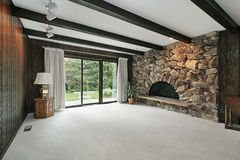 Family room with stone fireplace Stock Photo