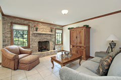Family room with stone fireplace Stock Images