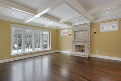 Family room with stone fireplace Royalty Free Stock Photo