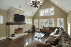 Family room with stone fireplace. Family room in luxury home with stone fireplace Royalty Free Stock Photography