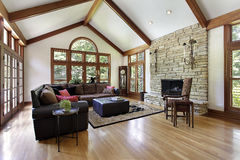 Family room with stone fireplace Royalty Free Stock Image