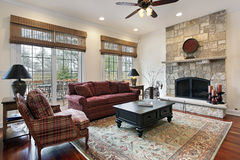 Family room with stone fireplace Stock Photos