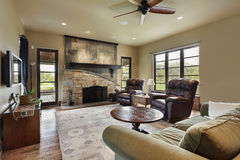 Family room with stone fireplace Stock Image