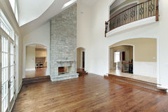 Family room with two story fireplace Royalty Free Stock Photo