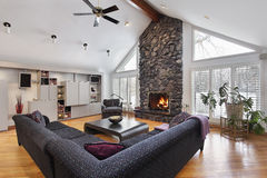 Family room with two story stone fireplace Royalty Free Stock Images