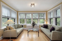 Family room with wall of windows Stock Images