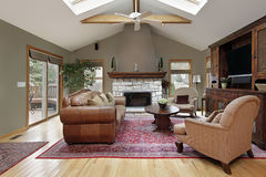 Family room with white brick fireplace royalty free stock photo