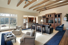 Family room with wood beams stock photography