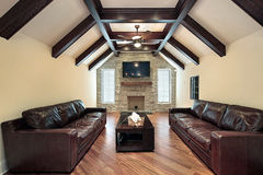 Family room with wood ceiling beams Royalty Free Stock Photos