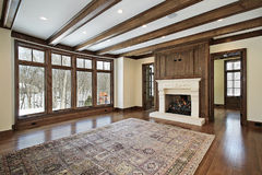 Family room with wood ceiling beams royalty free stock image