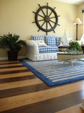 Family Room with Wood Floors. Beautiful blue and white couch with a nautical theme and wood floors Stock Photography