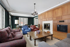 Family room with wood paneled cabinetry Stock Image