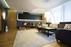 Family room with wooden floor Stock Photography