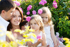 Family in rose flowers Stock Photos