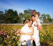 Family in rose garden Royalty Free Stock Photography