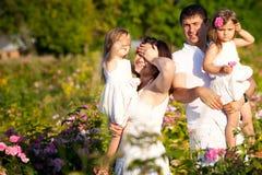 Family in rose garden Stock Photo