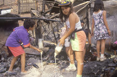 Family rummaging through home burned Stock Photography