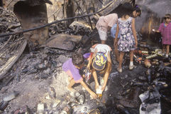 Family rummaging through home burned during riots Royalty Free Stock Images