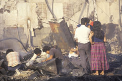 Family rummaging through home burned during riots, South Central Los Angeles, California Stock Photo