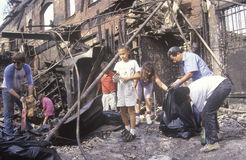 Family rummaging through home burned during riots, South Central Los Angeles, California Royalty Free Stock Photography