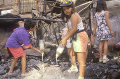 Family rummaging through home burned during riots, South Central Los Angeles, California Royalty Free Stock Photos