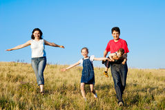 Family on the run. Father, mother, daughter and son Stock Images