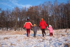 Family run from back in wood royalty free stock photography