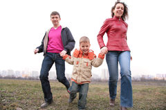 Family run outdoor in city on spring Stock Photo