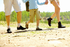 Family running. Image of happy family legs running down country road at summer Stock Images
