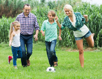 Family running with ball Stock Images