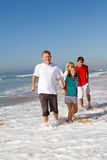 Family running on beach Stock Image