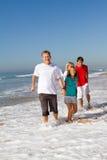 Family running on beach Stock Image
