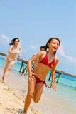 Family running on the beach royalty free stock image