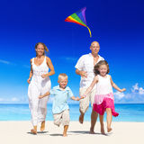 Family running on the beach Royalty Free Stock Photography