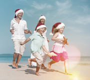 Family Running Beach Christmas Holiday Vacation Concept.  stock photo