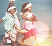Family Running Beach Christmas Summer Travel Concept.  Stock Photography