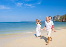Family running beach Happiness Playful Concept Stock Photography