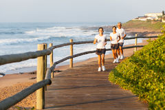 Family running beach Royalty Free Stock Image