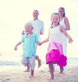 Family running on the beach Relaxation Concept Royalty Free Stock Photos